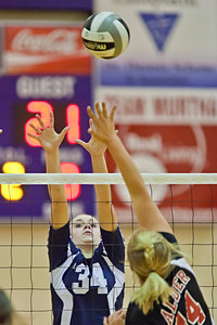 Bishop Hartley High School's #34 Madison Brake goes up against Jonathan Alder High School's #14 Kristina Hinch in their match-up in the Ohio High School Athletic Associations' 2010 Division II Central District Semifinal volleyball game held at Pickerington North High School Thursday night October 28, 2010. (© James D. DeCamp | http://www.JamesDeCamp.com | 614-367-6366)