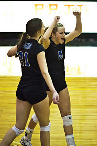 Hilliard Bradley High School's #21 Hayley Benson and #5 Meagan Howard react to a point scored against Buckeye Valley High School in the Ohio High School Athletic Associations' 2010 Division II Central District Semifinal volleyball game held at Pickerington North High School Thursday evening October 28, 2010. (© James D. DeCamp | http://www.JamesDeCamp.com | 614-367-6366)