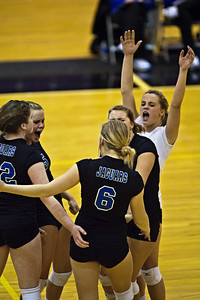 Hilliard Bradley High School's volleyball team reacts to a point scored against Buckeye Valley High School in the Ohio High School Athletic Associations' 2010 Division II Central District Semifinal volleyball game held at Pickerington North High School Thursday evening October 28, 2010. (© James D. DeCamp | http://www.JamesDeCamp.com | 614-367-6366)