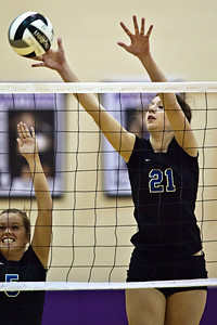 Hilliard Bradley High School's #21 Hayley Benson returns the ball in play against Buckeye Valley High School in the Ohio High School Athletic Associations' 2010 Division II Central District Semifinal volleyball game held at Pickerington North High School Thursday evening October 28, 2010. (© James D. DeCamp | http://www.JamesDeCamp.com | 614-367-6366)