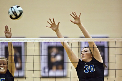 Hilliard Bradley High School's #30 Courtney Braun keeps her eye on the ball in play against Buckeye Valley High School in the Ohio High School Athletic Associations' 2010 Division II Central District Semifinal volleyball game held at Pickerington North High School Thursday evening October 28, 2010. (© James D. DeCamp | http://www.JamesDeCamp.com | 614-367-6366)