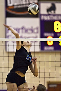 Hilliard Bradley High School's #21 Hayley Benson spikes the ball in play against Buckeye Valley High School in the Ohio High School Athletic Associations' 2010 Division II Central District Semifinal volleyball game held at Pickerington North High School Thursday evening October 28, 2010. (© James D. DeCamp | http://www.JamesDeCamp.com | 614-367-6366)