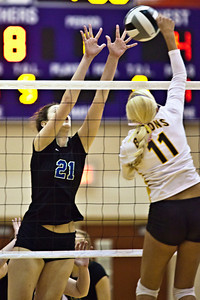 Hilliard Bradley High School's #21 Hayley Benson goes up against Buckeye Valley High School's #11 Calley Hawkins in the Ohio High School Athletic Associations' 2010 Division II Central District Semifinal volleyball game held at Pickerington North High School Thursday evening October 28, 2010. (© James D. DeCamp | http://www.JamesDeCamp.com | 614-367-6366)