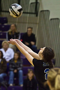 Hilliard Bradley High School's #21 Hayley Benson sets the ball in play against Buckeye Valley High School in the Ohio High School Athletic Associations' 2010 Division II Central District Semifinal volleyball game held at Pickerington North High School Thursday evening October 28, 2010. (© James D. DeCamp | http://www.JamesDeCamp.com | 614-367-6366)