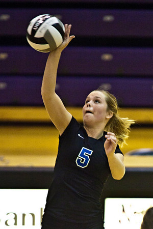 Hilliard Bradley High School's #5 Meagan Howard spikes the ball in play against Buckeye Valley High School in the Ohio High School Athletic Associations' 2010 Division II Central District Semifinal volleyball game held at Pickerington North High School Thursday evening October 28, 2010. (© James D. DeCamp   http://www.JamesDeCamp.com   614-367-6366)