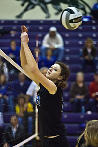 Hilliard Bradley High School's #21 Hayley Benson misses the ball in play against Buckeye Valley High School in the Ohio High School Athletic Associations' 2010 Division II Central District Semifinal volleyball game held at Pickerington North High School Thursday evening October 28, 2010. (© James D. DeCamp | http://www.JamesDeCamp.com | 614-367-6366)
