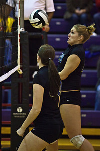Hilliard Bradley High School's #23 Chloe Long sets the ball in play against Buckeye Valley High School in the Ohio High School Athletic Associations' 2010 Division II Central District Semifinal volleyball game held at Pickerington North High School Thursday evening October 28, 2010. (© James D. DeCamp   http://www.JamesDeCamp.com   614-367-6366)