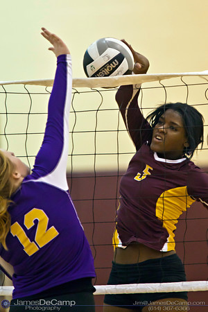 Licking Heights High School's Jemiah Powell (5) spikes the ball against Millersport High School's Emma Spurlock (12) Tuesday night October 11, 2011 at Licking Heights High School.  The Licking Heights team won three straight games for the victory. (© James D. DeCamp | http://www.JamesDeCamp.com | 614-367-6366)