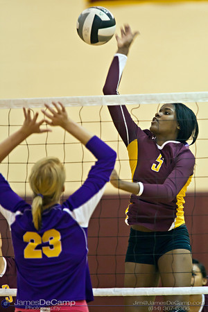 Licking Heights High School's  (##) spikes the ball against Millersport High School Tuesday night October 11, 2011 at Licking Heights High School.  The Licking Heights team won three straight games for the victory. (© James D. DeCamp | http://www.JamesDeCamp.com | 614-367-6366)