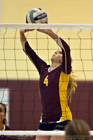 Licking Heights High School's Katie Kenney (4) sets the ball for a teammate in their first game against Millersport High School Tuesday night October 11, 2011 at Licking Heights High School.  The Licking Heights team won three straight games for the victory. (© James D. DeCamp | http://www.JamesDeCamp.com | 614-367-6366)