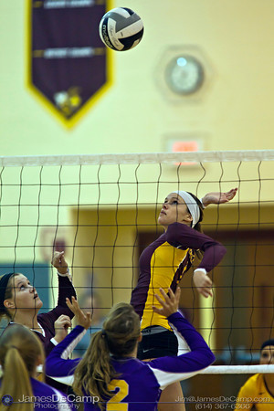 Licking Heights High School's Elizabeth Daugherty (1) spikes the ball against Millersport High School Tuesday night October 11, 2011 at Licking Heights High School.  The Licking Heights team won three straight games for the victory. (© James D. DeCamp | http://www.JamesDeCamp.com | 614-367-6366)