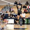 Central Noble Cougars setter Jenica Berkes (13) sets the ball for her teammate during Thursdays game at Fairfield Jr./Sr. High School in Benton.