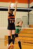 Katie Moore tries to block a ball spiked by Alyone Dmitruk