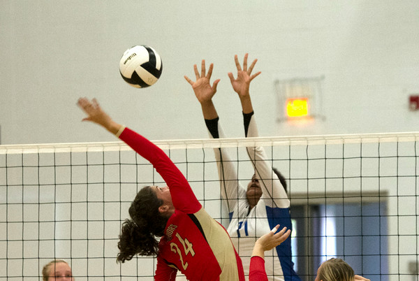 SAM HOUSEHOLDER | THE GOSHEN NEWS<br /> Westview sophomore Taylor Eash hits the ball while Bethany Christian junior Darienne Maust tries to block during the game Tuesday.