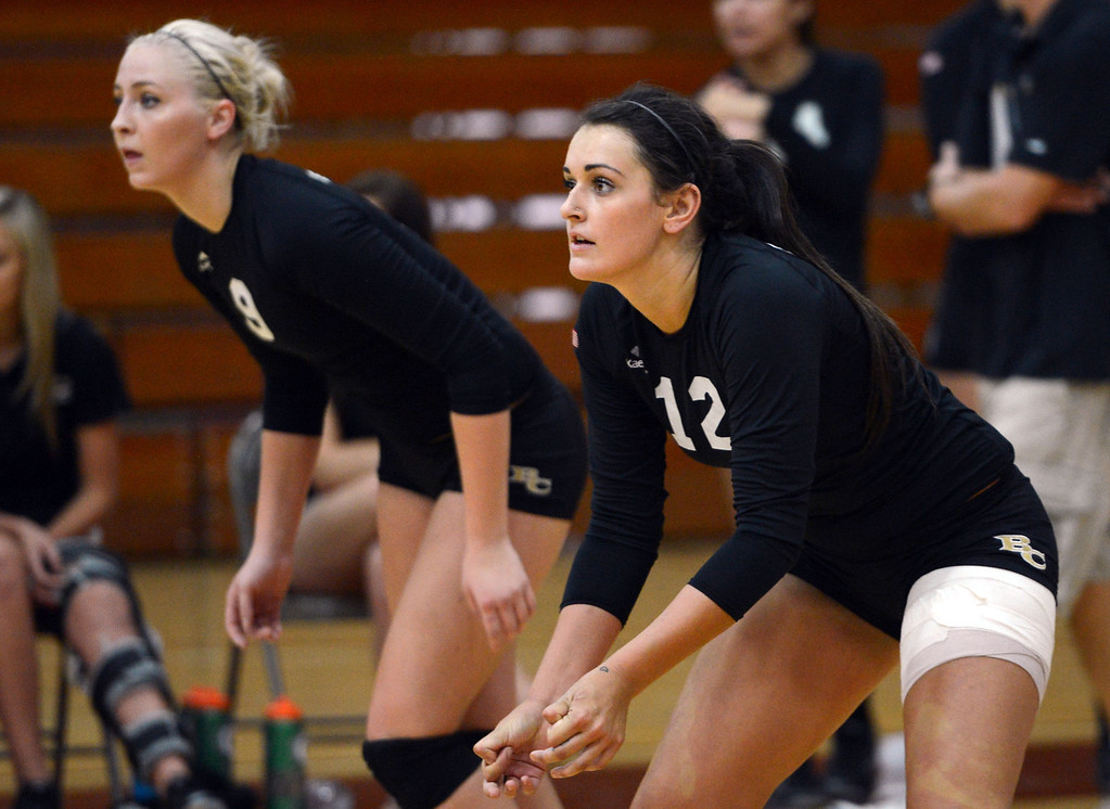 . Butte College\'s #9 Colleen Tade (left) and #12 Callie Flood (right) ready against Chico State in their volleyball game at CSUC Acker Gym Saturday, August 24, 2013 in Chico, Calif.  (Jason Halley/Chico Enterprise-Record)