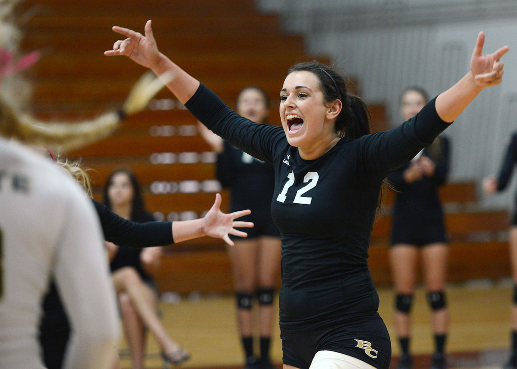 . Butte College\'s #12 Callie Flood reacts to a score against Chico State in their volleyball game at CSUC Acker Gym Saturday, August 24, 2013 in Chico, Calif.  (Jason Halley/Chico Enterprise-Record)