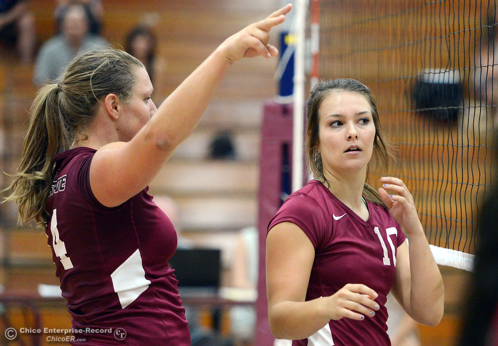 . Chico State\'s #14 Alex Shurtz (left) and #10 Ashton Kershner (right) look on against Butte College in their volleyball game at CSUC Acker Gym Saturday, August 24, 2013 in Chico, Calif.  (Jason Halley/Chico Enterprise-Record)