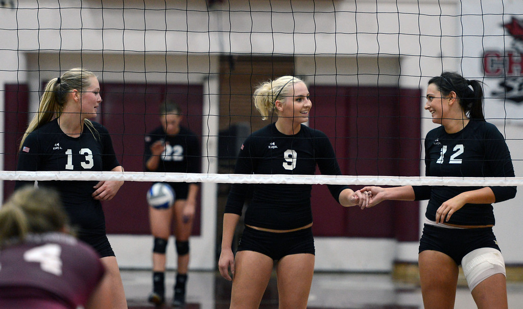 . Butte College\'s #13 Emilie Aase, #9 Colleen Tade, and #12 Callie Flood (left to right) ready against Chico State in their volleyball game at CSUC Acker Gym Saturday, August 24, 2013 in Chico, Calif.  (Jason Halley/Chico Enterprise-Record)