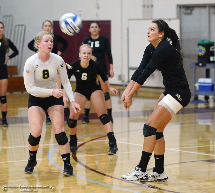 . Butte College\'s #8 Mikaela Woodbury (left) and #6 Lacie Landrum (center) watch #12 Callie Flood (right) hit against Chico State in their volleyball game at CSUC Acker Gym Saturday, August 24, 2013 in Chico, Calif.  (Jason Halley/Chico Enterprise-Record)