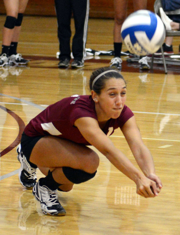 . Chico State\'s #7 Shannon Cotton dives for a dig against Butte College in their volleyball game at CSUC Acker Gym Saturday, August 24, 2013 in Chico, Calif.  (Jason Halley/Chico Enterprise-Record)
