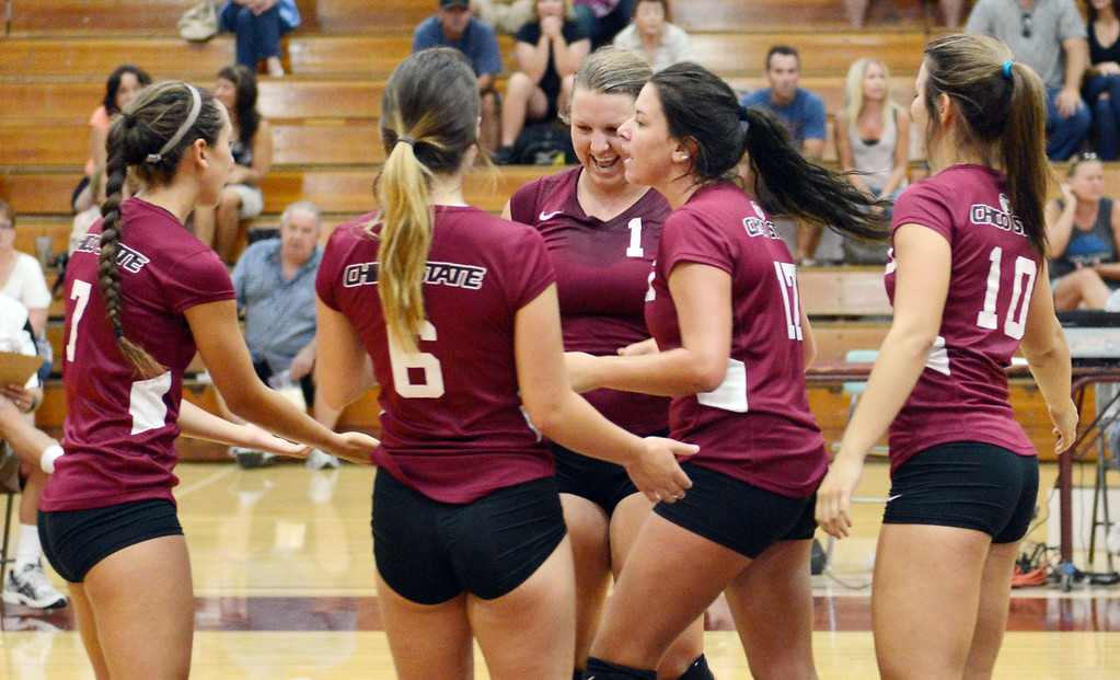 . Chico State\'s #7 Shannon Cotton, #6 Molly Ratto, #14 Alex Shurtz, #17 Torey Thompson, and #10 Ashton Kershner (left to right) celebrate a score against Butte College in their volleyball game at CSUC Acker Gym Saturday, August 24, 2013 in Chico, Calif.  (Jason Halley/Chico Enterprise-Record)