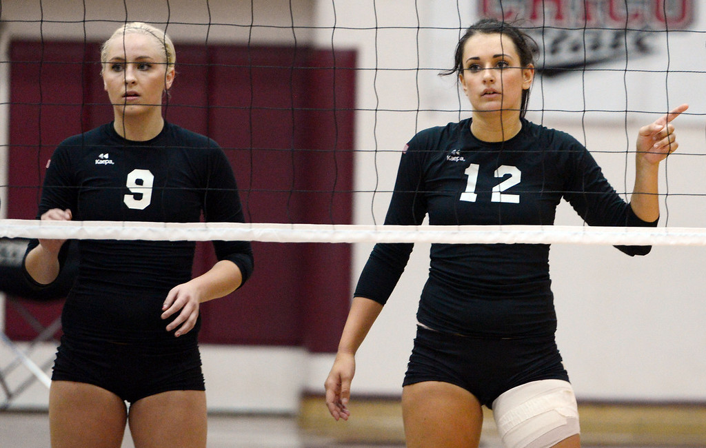 . Butte College\'s #9 Coleen Tade (left) and #12 Callie Flood (right) ready against Chico State in their volleyball game at CSUC Acker Gym Saturday, August 24, 2013 in Chico, Calif.  (Jason Halley/Chico Enterprise-Record)