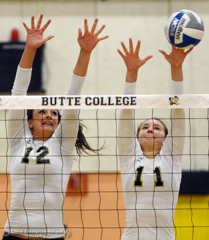 . Butte College\'s #12 Callie Flood (left) and #11 Brooke Silverman (right) attempt to block against Sac City College\' #9 Elliza North (not seen) in the first game of their women\'s volleyball match at Butte\'s Cowan Gym Wednesday, September 25, 2013, in Oroville, Calif.  (Jason Halley/Chico Enterprise-Record)