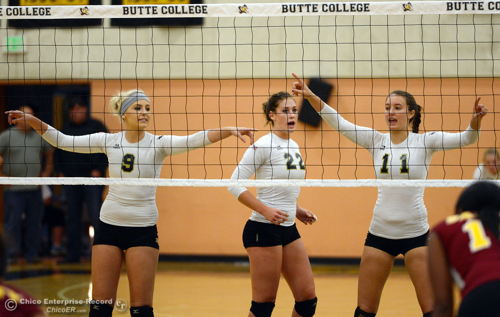 . Butte College\'s #9 Colleen Tade, #22 Courtney Robinson, and #11 Brooke Silverman (left to right) ready against Sac City College in the first game of their women\'s volleyball match at Butte\'s Cowan Gym Wednesday, September 25, 2013, in Oroville, Calif.  (Jason Halley/Chico Enterprise-Record)
