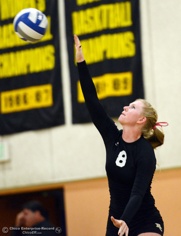 . Butte College\'s #8 Mikaela Woodbury serves against Sac City College in the first game of their women\'s volleyball match at Butte\'s Cowan Gym Wednesday, September 25, 2013, in Oroville, Calif.  (Jason Halley/Chico Enterprise-Record)