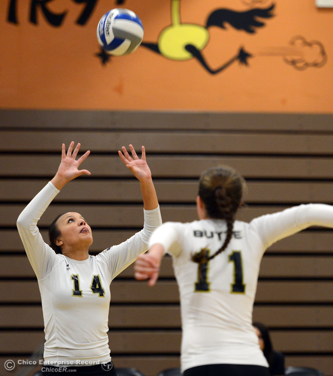 . Butte College\'s #14 Gabby Delarosa (left) sets the ball for #11 Brooke Silverman (right) against Sac City College in the first game of their women\'s volleyball match at Butte\'s Cowan Gym Wednesday, September 25, 2013, in Oroville, Calif.  (Jason Halley/Chico Enterprise-Record)