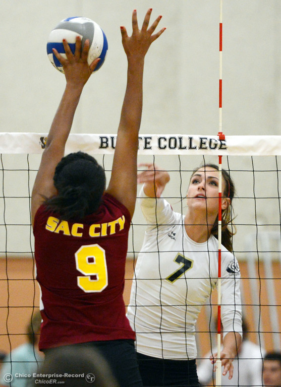 . Butte College\'s #7 Taylor Johnson (right) spikes against Sac City College\' #9 Elliza North (left) in the first game of their women\'s volleyball match at Butte\'s Cowan Gym Wednesday, September 25, 2013, in Oroville, Calif.  (Jason Halley/Chico Enterprise-Record)