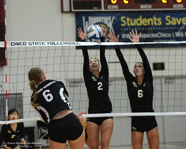 Anna Baytosh (6) spikes the ball into the arms of Butte College Roadrunners Alyssa Hardesty (2) and Brianna Souza (6) during a scrimmage between the Butte College and Chico State volleyball teams Saturday, Aug. 20, 2016, at Acker Gym in Chico, California. (Dan Reidel -- Enterprise-Record)