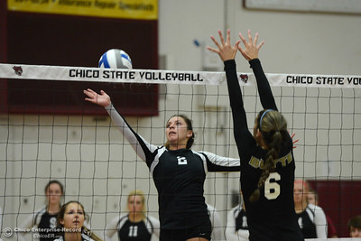 Chico State's Olivia Mediano (2) hits the ball against Butte College's Brianna Souza (6) during a volleyball scrimmage Saturday, Aug. 20, 2016, at Acker Gym in Chico, California. (Dan Reidel -- Enterprise-Record)
