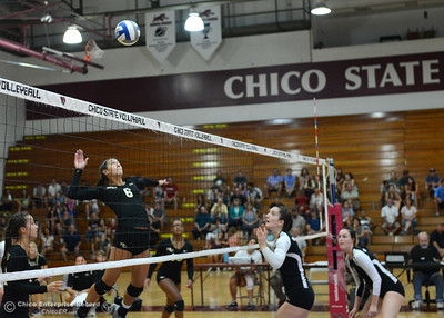 Butte College's Brianna Souza (6) leaps to spike the ball as the Roadrunners play the Chico State volleyball team Saturday, Aug. 20, 2016, at Acker Gym in Chico, California. (Dan Reidel -- Enterprise-Record)