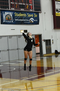 Timolin KEpon leaps to serve the ball for the Roadrunners as Butte College plays the Chico State Volleyball team Saturday, Aug. 20, 2016, at Acker Gym in Chico, California. (Dan Reidel -- Enterprise-Record)