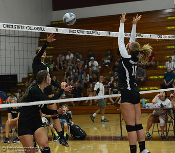 Butte College's Jessica Curl (18) fakes a spike as Baylie Willis (8) hits the ball over the net to score a point for the Roadrunners against Chico State's Ashton Kershner (10) on Saturday, Aug. 20, 2016, at Acker Gym in Chico, California. (Dan Reidel -- Enterprise-Record)