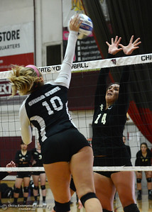Chico State's Ashton Kershner (10) hits the ball against Butte College's Marissa Weber (14) as the Roadrunners play the Wildcats volleyball team Saturday, Aug. 20, 2016, at Acker Gym in Chico, California. (Dan Reidel -- Enterprise-Record)
