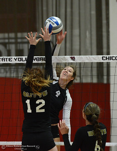 Chico State's Bekah Boyle (4) hits the ball over the net against Butte College's Morgan Raschein (12) and Brianna Souza (6) as the Roadrunners and Wildcats volleyball teams scrimmage Saturday, Aug. 20, 2016, at Acker Gym in Chico, California. (Dan Reidel -- Enterprise-Record)