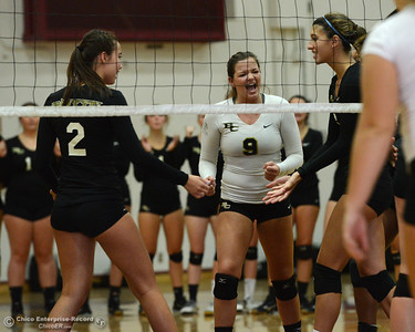 Butte College Roadrunners, left to right, Alyssa Hardesty (2), Sarah Novak (9) and Brianna Souza celebrate a point as the Roadrunners play the Chico State volleyball team Saturday, Aug. 20, 2016, at Acker Gym in Chico, California. (Dan Reidel -- Enterprise-Record)