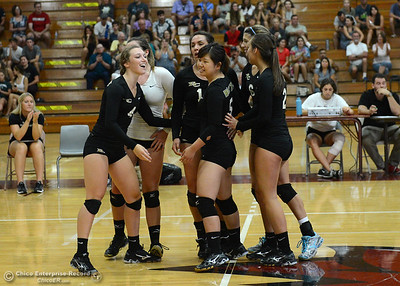 The Butte College Roadrunners congratulate each other as the play the Chico State volleyball team Saturday, Aug. 20, 2016, at Acker Gym in Chico, California. (Dan Reidel -- Enterprise-Record)