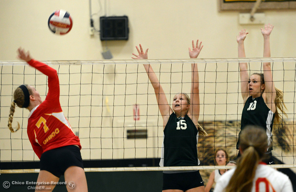 . Chico High\'s #7 Allysa Barrett (left) against Paradise High\'s #15 Emilee Heinke (center) and #10 Larissa Knifong (right) in the first game of their girls volleyball match at PHS Thursday, October 10, 2013 in Paradise, Calif.  (Jason Halley/Chico Enterprise-Record)