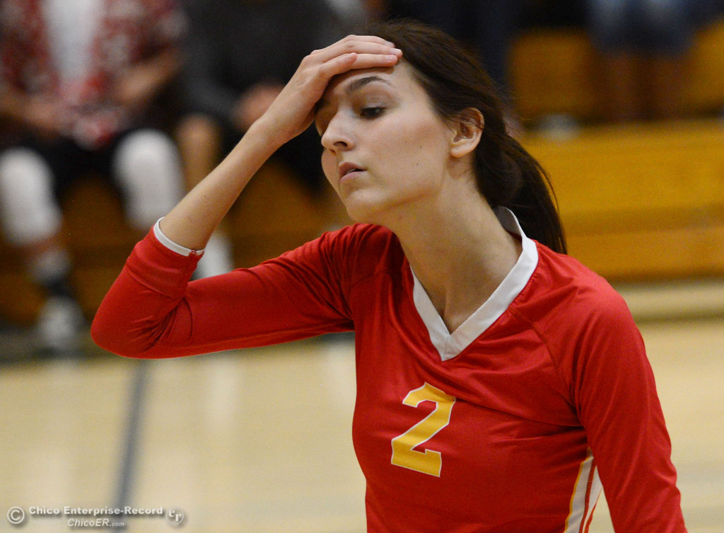 . Chico High\'s #2 Sydney Gaskey wipes her brow against Paradise High in the second game of their girls volleyball match at PHS Thursday, October 10, 2013 in Paradise, Calif.  (Jason Halley/Chico Enterprise-Record)