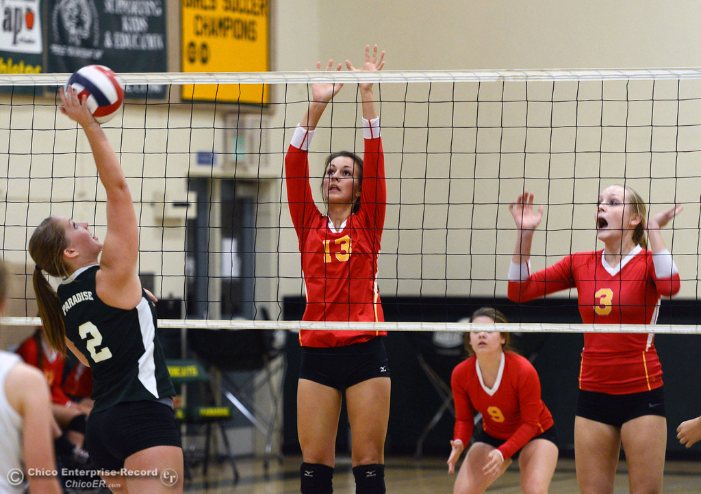 . Paradise High\'s #2 Bailey Bengson (left) spikes against Chico HIgh\'s #13 Becca Korte (center) and #3 KC Sicheneder (right) in the second game of their girls volleyball match at PHS Thursday, October 10, 2013 in Paradise, Calif.  (Jason Halley/Chico Enterprise-Record)