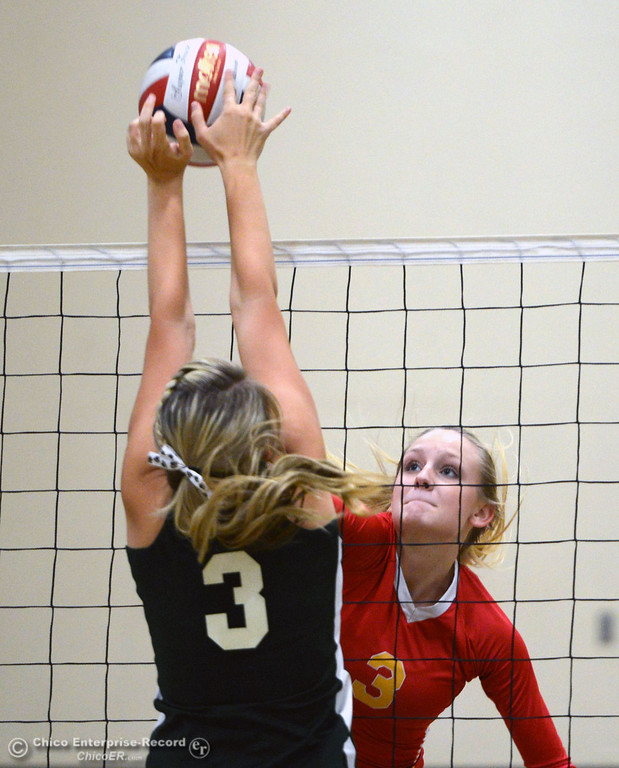 . Paradise High\'s #3 Kelsi Earhart (bottom) blocks a hit by Chico High\'s #3 KC Sicheneder (top) in the second game of their girls volleyball match at PHS Thursday, October 10, 2013 in Paradise, Calif.  (Jason Halley/Chico Enterprise-Record)