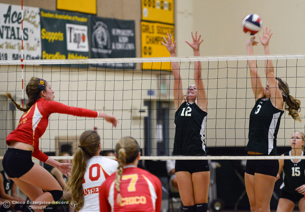 . Chico High\'s #8 Emma Contreras (left) spikes against Paradise High\'s #12 Mariah Mundt (center) and #3 Kelsi Earhart (right) in the first game of their girls volleyball match at PHS Thursday, October 10, 2013 in Paradise, Calif.  (Jason Halley/Chico Enterprise-Record)