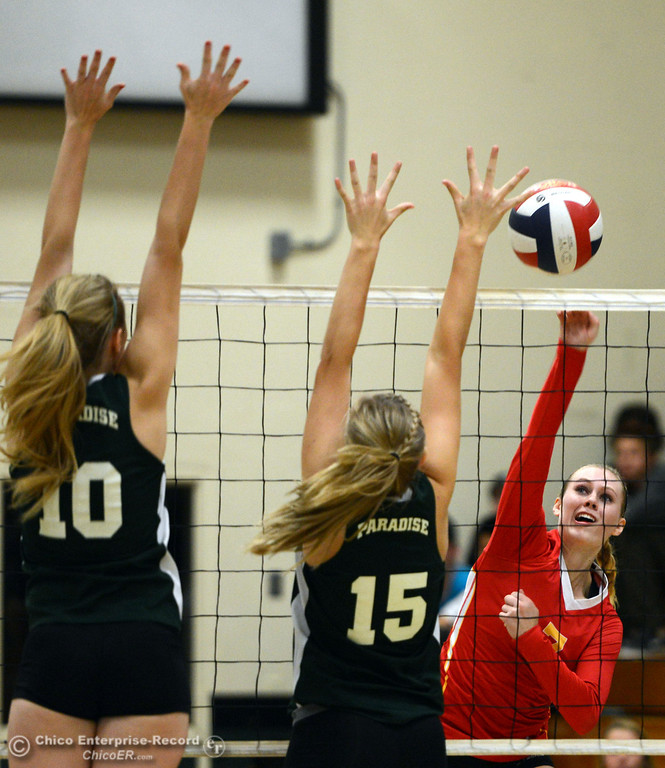 . Chico High\'s #7 Allysa Barrett (right) spikes the ball against Paradise High\'s #15 Emilee Heinke (center) and #10 Larissa Knifong (left) in the second game of their girls volleyball match at PHS Thursday, October 10, 2013 in Paradise, Calif.  (Jason Halley/Chico Enterprise-Record)