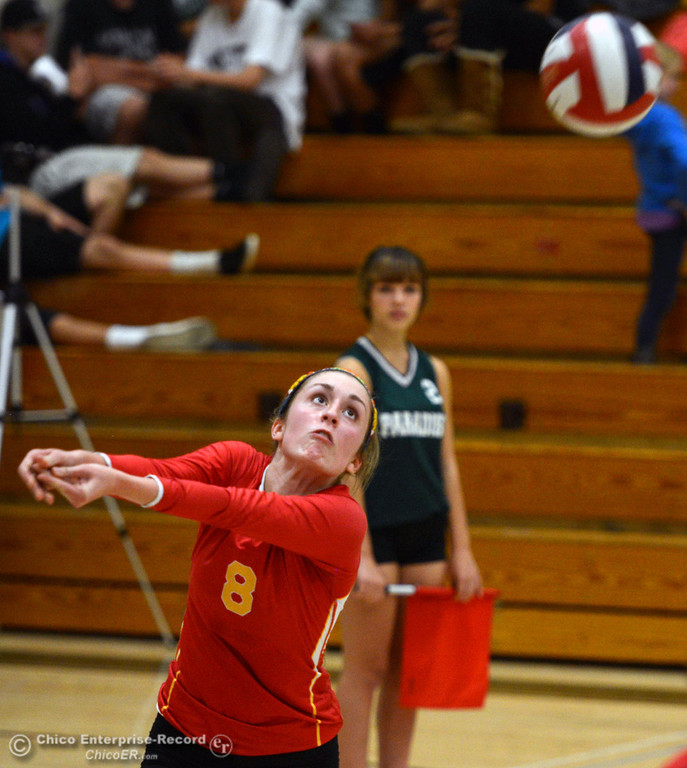 . Chico High\'s #8 Emma Contreras takes a dig against Paradise High in the second game of their girls volleyball match at PHS Thursday, October 10, 2013 in Paradise, Calif.  (Jason Halley/Chico Enterprise-Record)