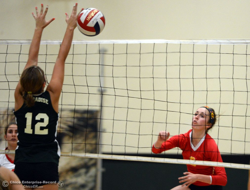 . Chico High\'s #8 Emma Contreras (right) spikes against Paradise High\'s #12 Mariah Mundt (left) in the second game of their girls volleyball match at PHS Thursday, October 10, 2013 in Paradise, Calif.  (Jason Halley/Chico Enterprise-Record)