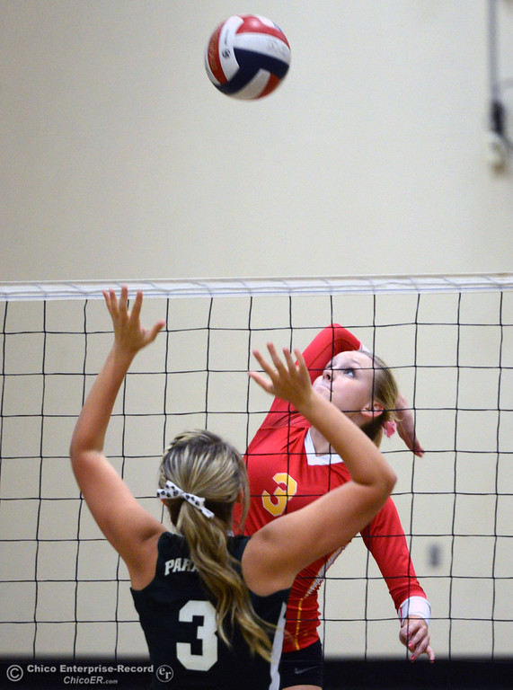 . Chico High\'s #3 KC Sicheneder (top) spikes against Paradise High\'s #3 Kelsi Earhart (bottom) in the second game of their girls volleyball match at PHS Thursday, October 10, 2013 in Paradise, Calif.  (Jason Halley/Chico Enterprise-Record)