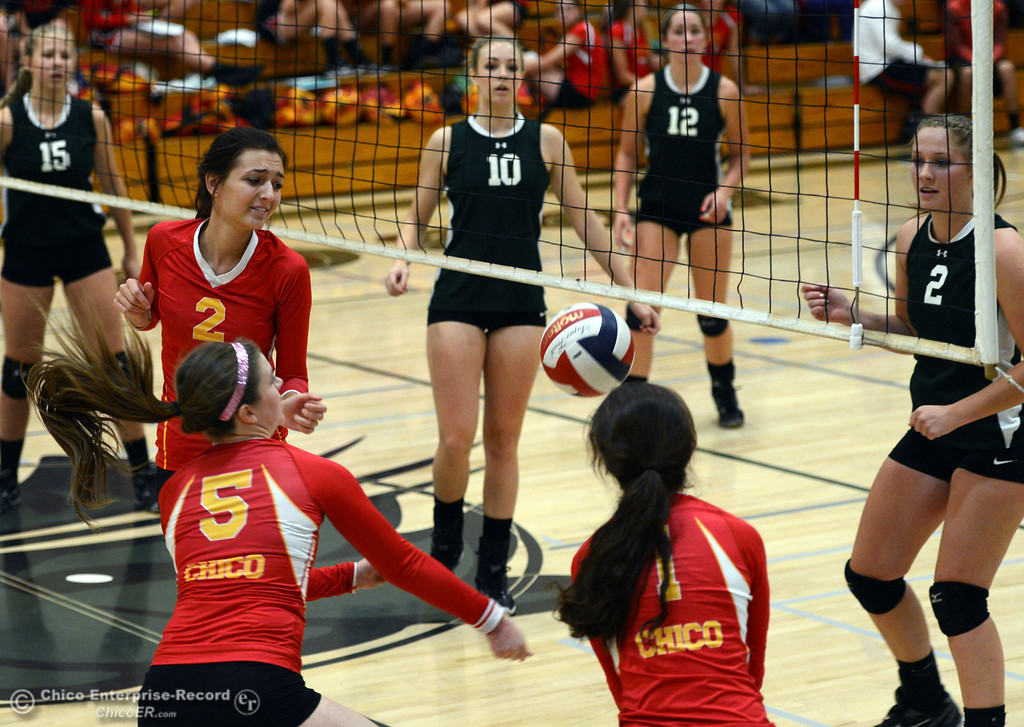 . Chico High\'s #2 Sydney Gaskey, #5 Amanda Manning, and #1 Cia Seibert (left to right) are unable to make a save against Paradise High in the second game of their girls volleyball match at PHS Thursday, October 10, 2013 in Paradise, Calif.  (Jason Halley/Chico Enterprise-Record)